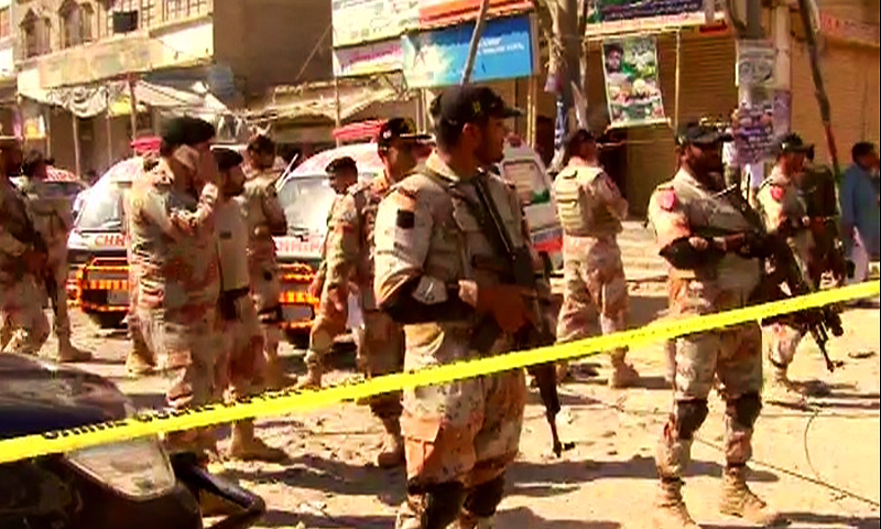 Paramilitary soldiers stand guard at the crime scene.– DawnNews