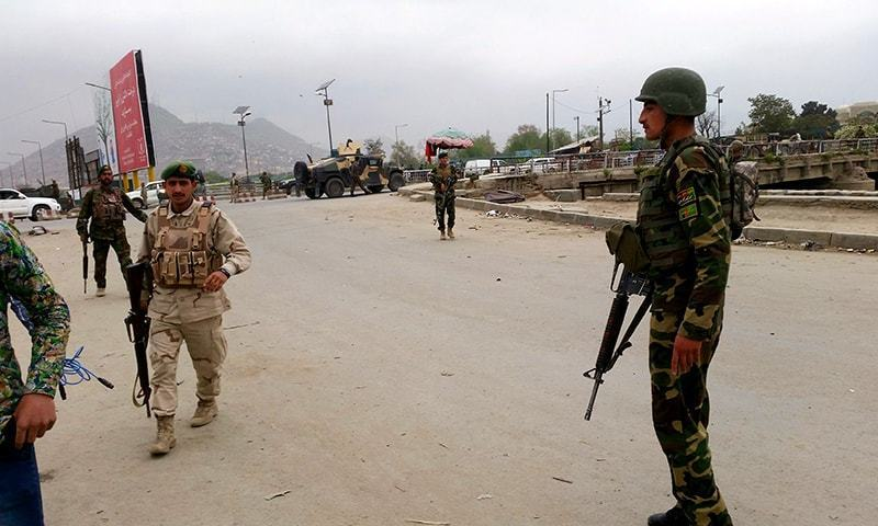 Security forces members keep watch at the site of an explosion in Kabul, Afghanistan April 19, 2016. ─ Reuters
