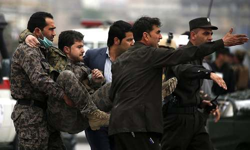 Afghan security forces carry an injured security personnel after a suicide car bomb attack in Kabul, Afghanistan April 19, 2016. ─ Reuters