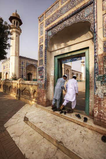 Young boys enter the Eid Gah mosque in Multan that serves as a madrasa between prayer hours | Kohi Marri