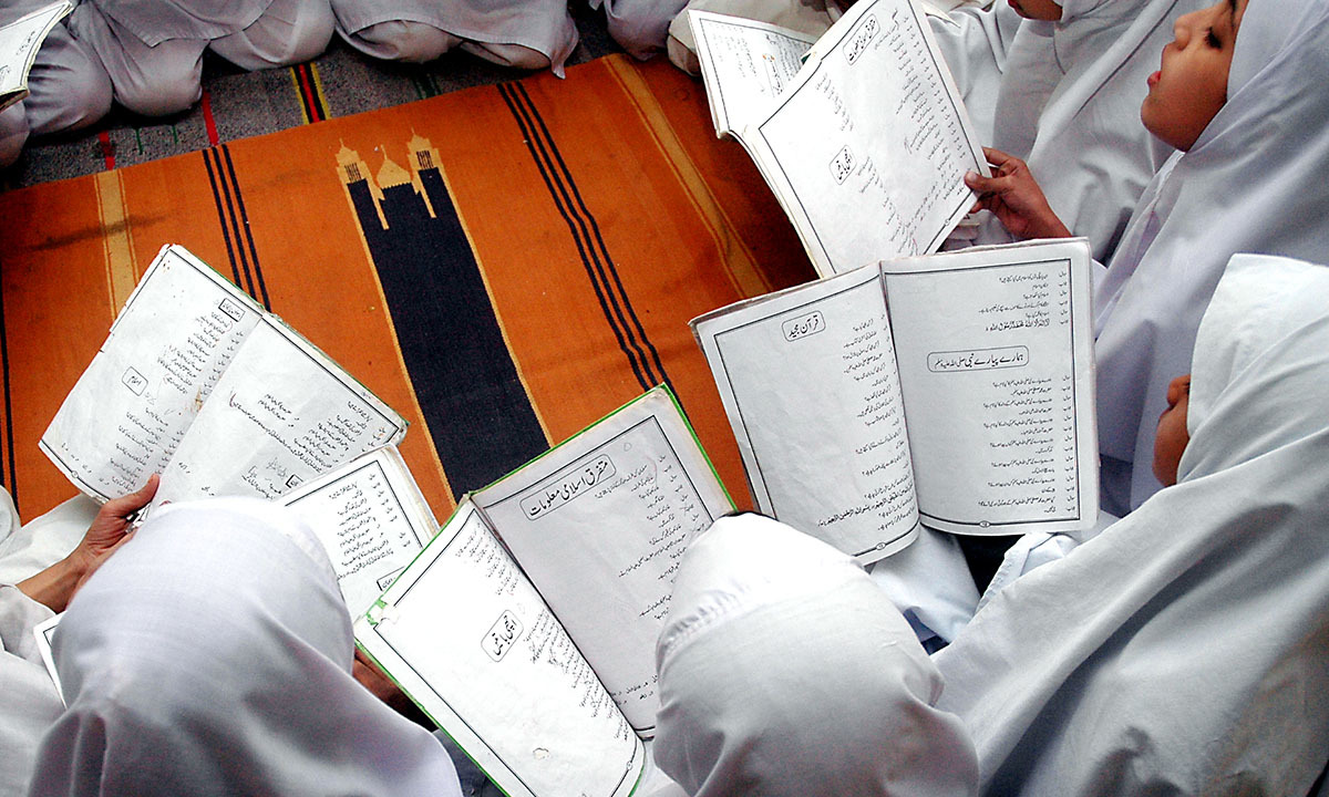 Girls read Islamic texts in a madrasa in Malir, Karachi   Fahim Siddiqui, White Star