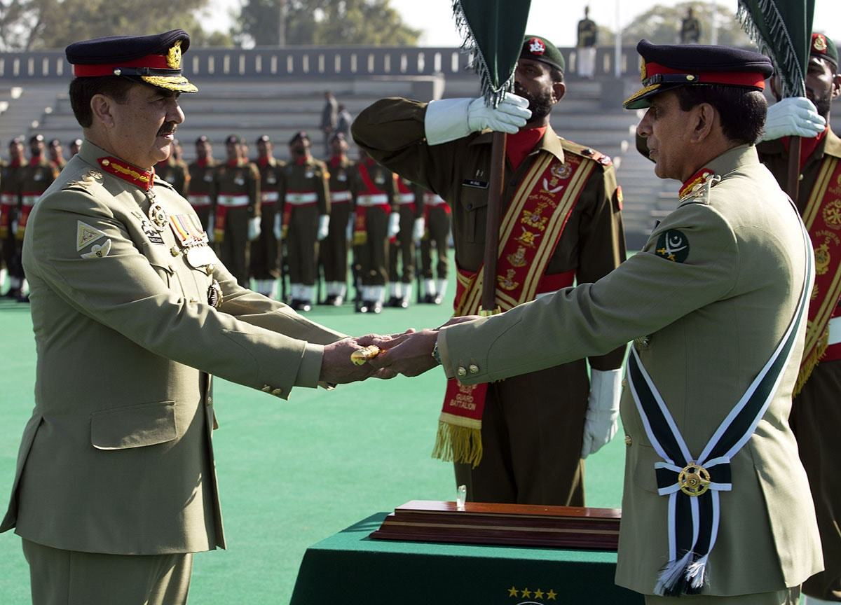 General Ashfaq Parvez Kayani hands over a ceremonial baton to his successor General Raheel Sharif | AFP