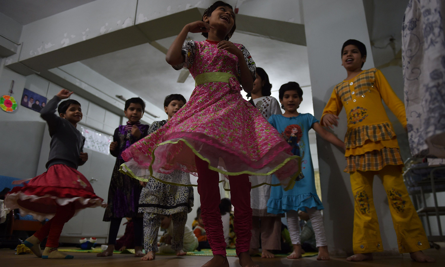 Orphaned children play at the Edhi Foundation in Karachi.   – AFP