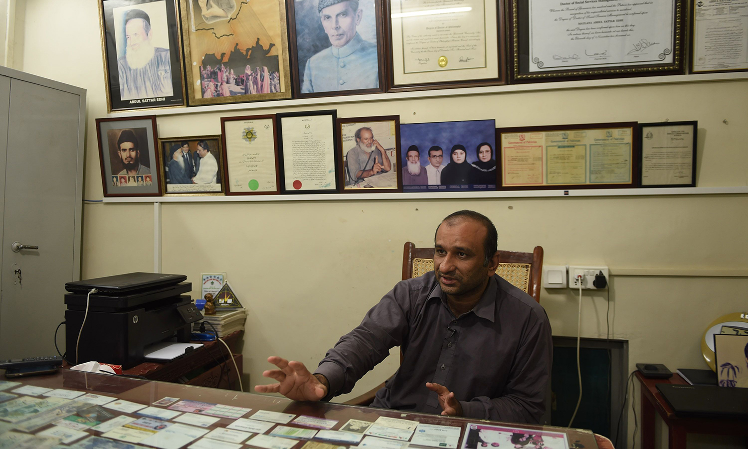Faisal Edhi, son of Abdul Sattar Edhi, speaks in his office in Karachi.   – AFP