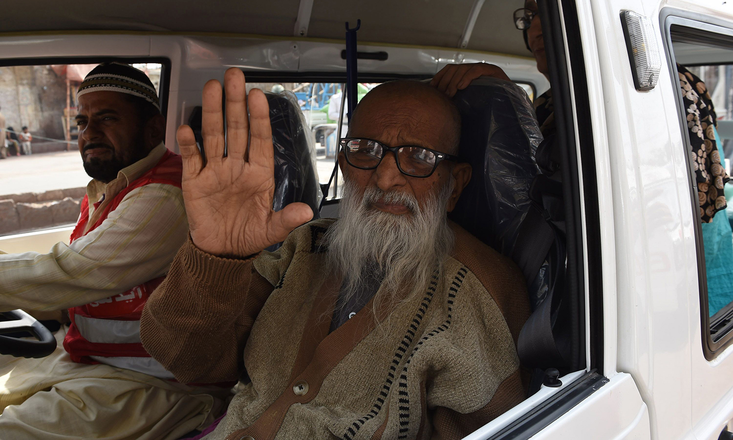 Abdul Sattar Edhi waves as he journeys to his office in Karachi. – AFP