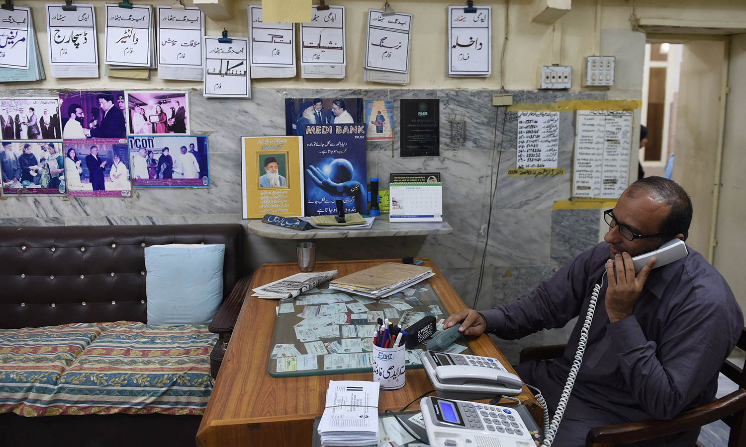 Faisal Edhi speaks on the telephone in his office Karachi.  – AFP