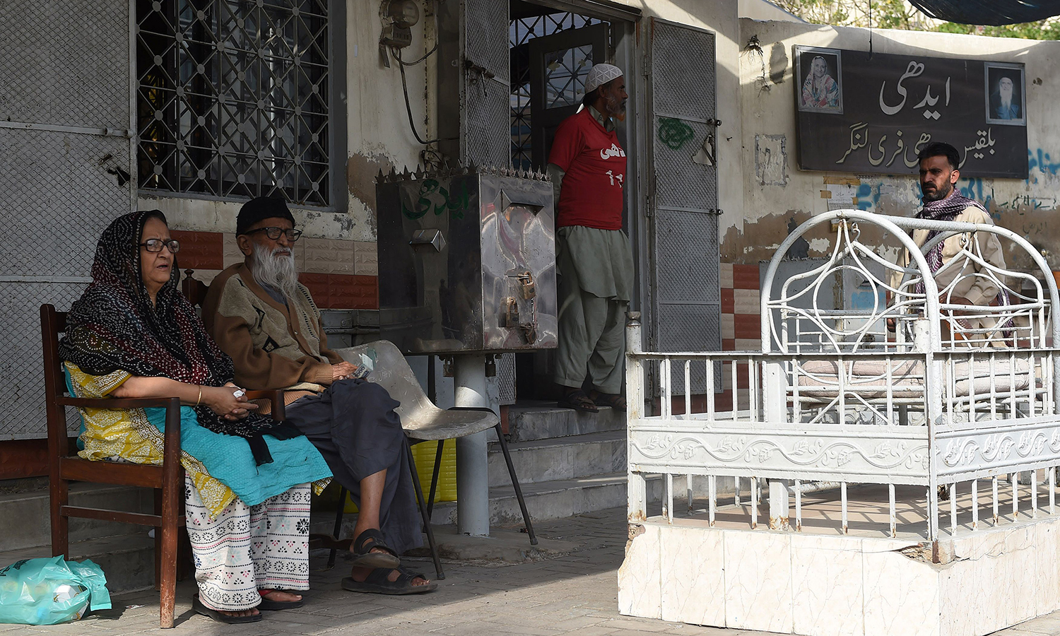 Abdul Sattar Edhi sits with his wife Bilquis Edhi outside his office in Karachi.   – AFP