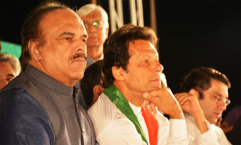 PTI chairman Imran Khan and party spokesman Naeemul Haq during the PTI Foundation day rally in Islamabad.─ PTI Facebook page