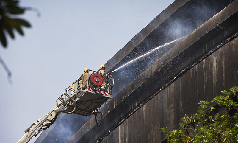 Firefighters try to extinguish a fire in the National Museum of Natural History in New Delhi. ─ AP