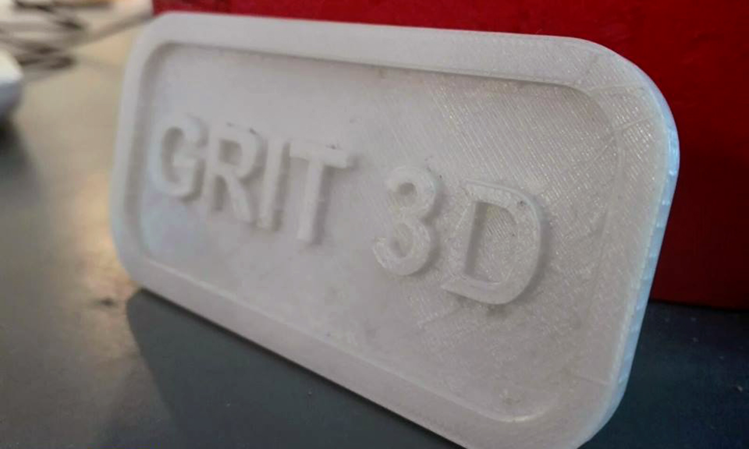 A 3D-printed logo. —Photo courtesy Grit 3D