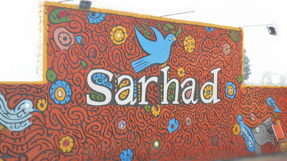 Dove the symbol of peace forms the emblem of Sarhad