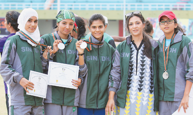 MEMBERS of Sindh women's relay team, (L to R) Almas Ibrahim, Sadia Bashir, Shafaq Aarfeen, Roma Altaf and Salwa Farid pose with their medals.—Photo by writer