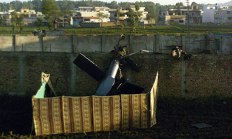This file photograph taken on May 2, 2011 shows s crashed military helicopter is near the hideout of Al Qaeda leader Osama bin Laden after a ground operation by US Special Forces in Abbottabad. — AFP/File