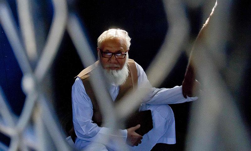 This file photograph taken on October 29, 2014, shows Bangladeshi Jamaat-e-Islami party leader Motiur Rahman Nizami as he sits inside a van while being taken to a prison after being sentenced at the International Crimes Tribunal court in Dhaka.— AFP