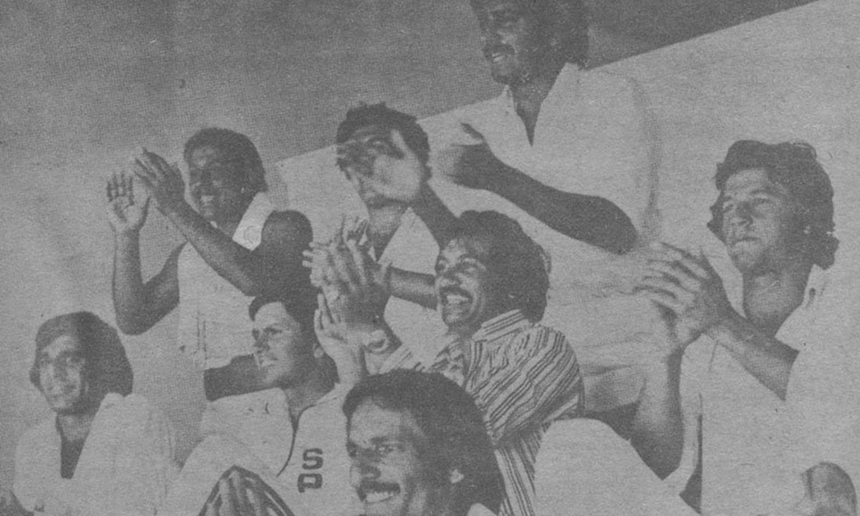 Pakistani dressing room applauds Asif's century. From left: Haroon, Salim Altaf, Wasim Bari (slightly hidden), Majid, Sardraz, Sadiq, Imran and Taslim Arif.
