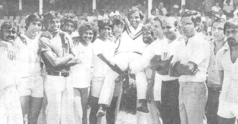 Pakistani players lift their captain after squaring the series. (From left): Iqbal Qasim, Mohsin Khan, Haroon, Sarfaraz, Bari, Miandad, Imran, Mushtaq, Sadiq, Asif, Intikhab, Zaheer, Salim Altaf and Wasim Raja.