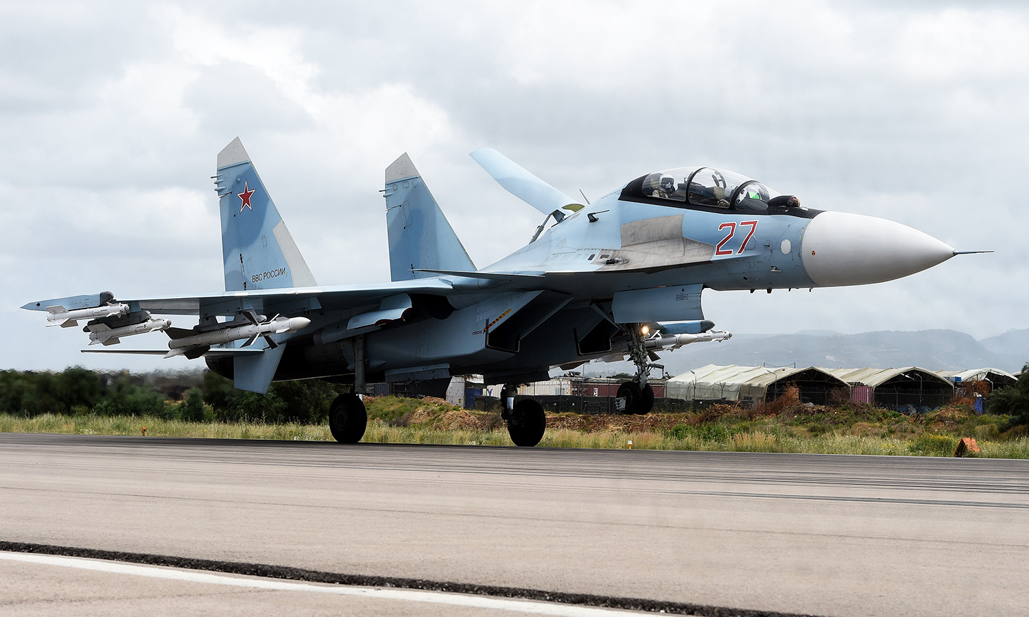 A Russian Sukhoi Su-35 bomber lands at the Russian Hmeimim military base in Latakia province. -AFP