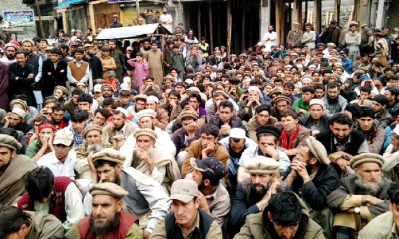 Protesters stage a sit-in on Karakoram Highway on Thursday. — Dawn