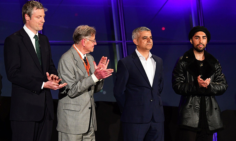 Newly elected London Mayor Sadiq Khan (2nd R) is congratulated by other candidates including Conservative Pary candidate Zac Goldsmith (L) following his election victory at City Hall in central London on May 7, 2016. —AFP