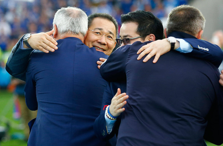 Claudio Ranieri celebrates winning the Barclays Premier League with Chairman Vichai Srivaddhanaprabha and Vice Chairman Aiyawatt Srivaddhanaprabha. — Reuters