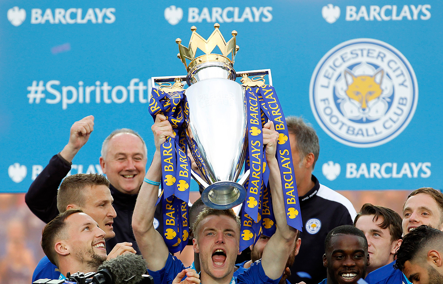 Leicester City's Jamie Vardy lifts the trophy as they celebrate winning the Barclays Premier League. — Reuters