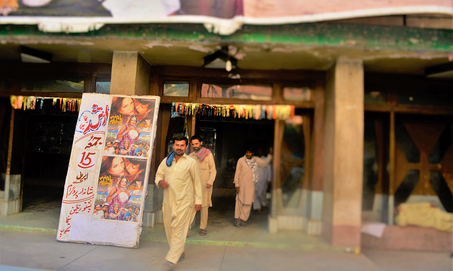 A man walks out of Peshawar's Arshad Cinema — Photo by author
