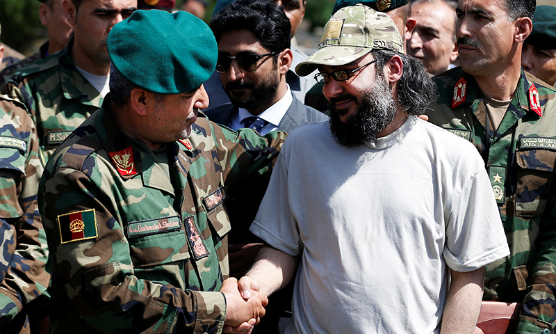 Ali Haider Gilani, (R), shakes hands with Afghan Joint Chief of Staff Gen. Qadamshah Shahim at the Defence Ministry in Kabul, Afghanistan May 11, 2016. —Reuters