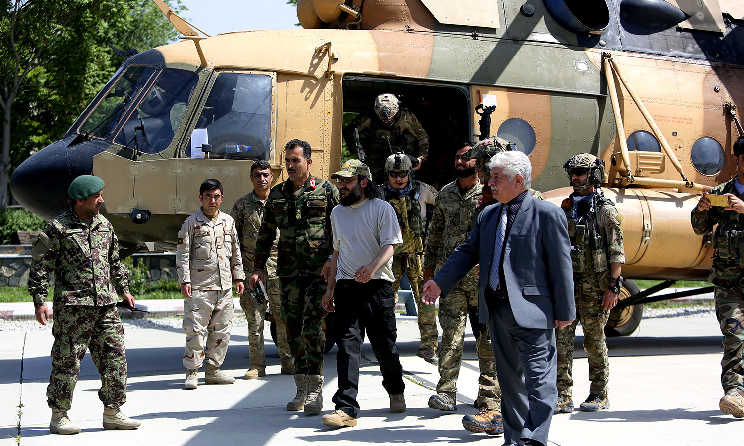 Ali Haidar Gilani emerges from helicopter as he arrives at the Afghan Ministry of Defense. -AP
