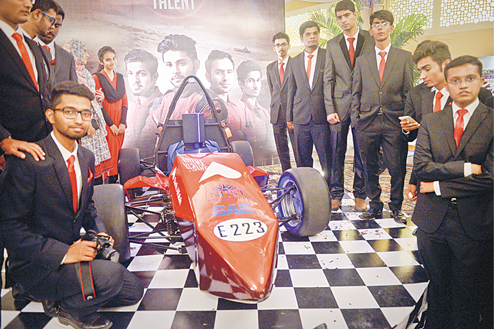 The proud PNEC-NUST team with their Formula Electric car.—Fahim Siddiqi/White Star