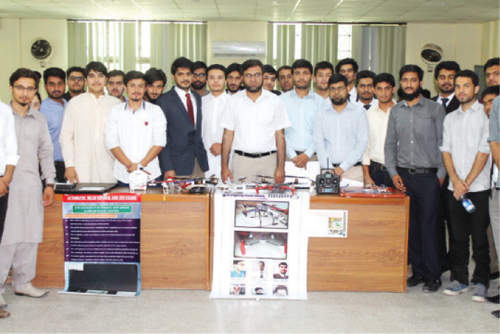 Students showcase their projects at the exhibition. —Dawn