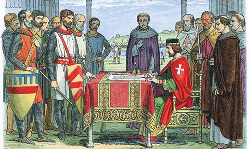 A woodcut from 1864 depicting King John and the barons at Runnymede, England signing the Magna Carta -Courtesy of Universal History Archive/Un/REX