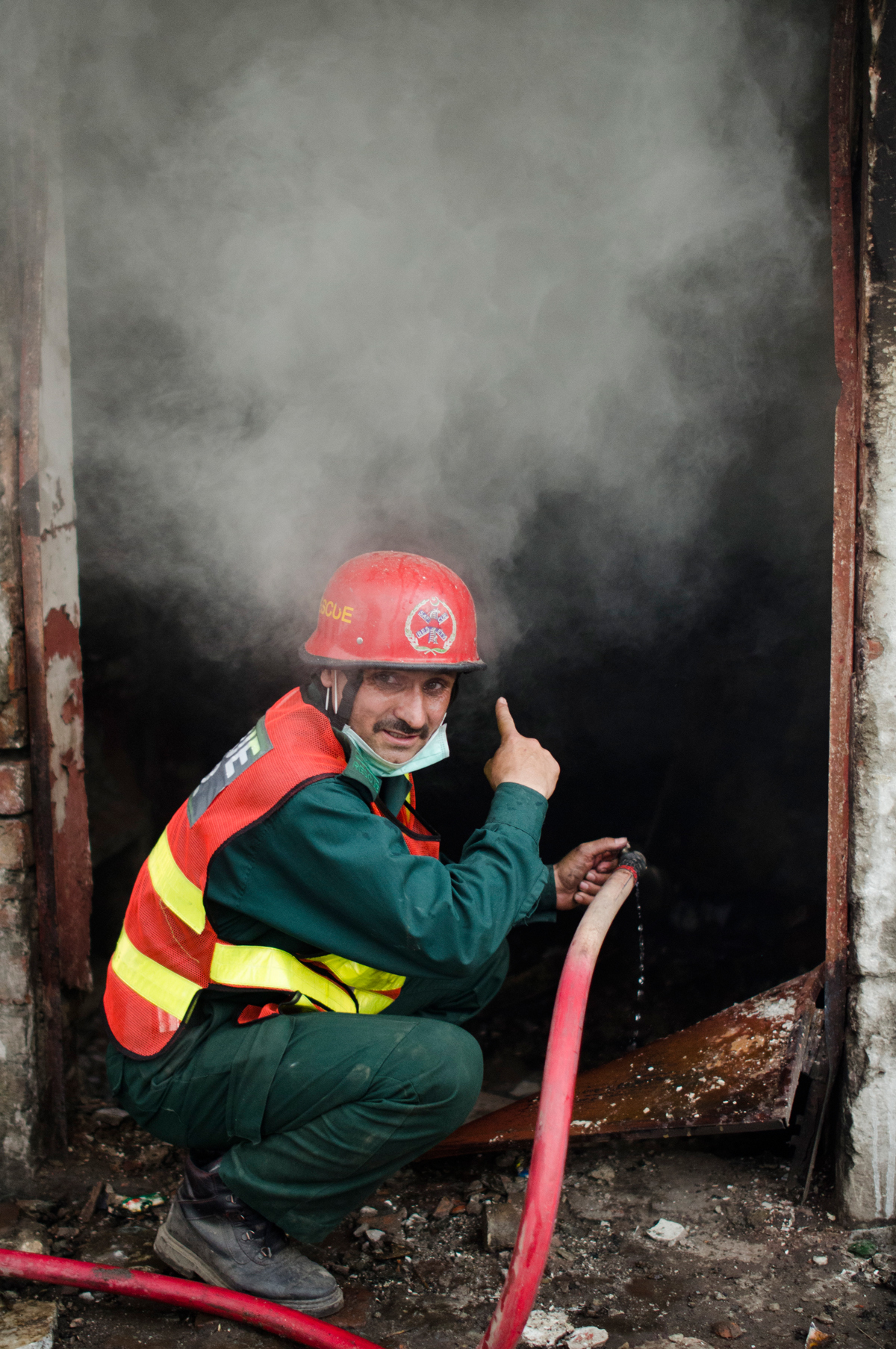 A firefighter in Joseph Colony, Lahore | Saad Sarfaraz
