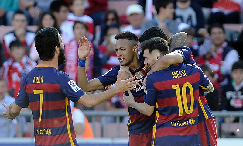 Barcelona's Uruguayan forward Luis Suarez (hidden) celebrates with Barcelona's Brazilian forward Neymar (2ndL) and Barcelona's Argentinian forward Lionel Messi(R) after scoring during the Spanish league football match.─AFP
