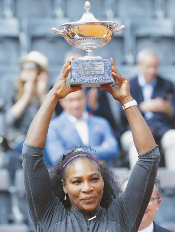SERENA Williams lifts the trophy after the Italian Open final against Madison Keys on Sunday.—AP