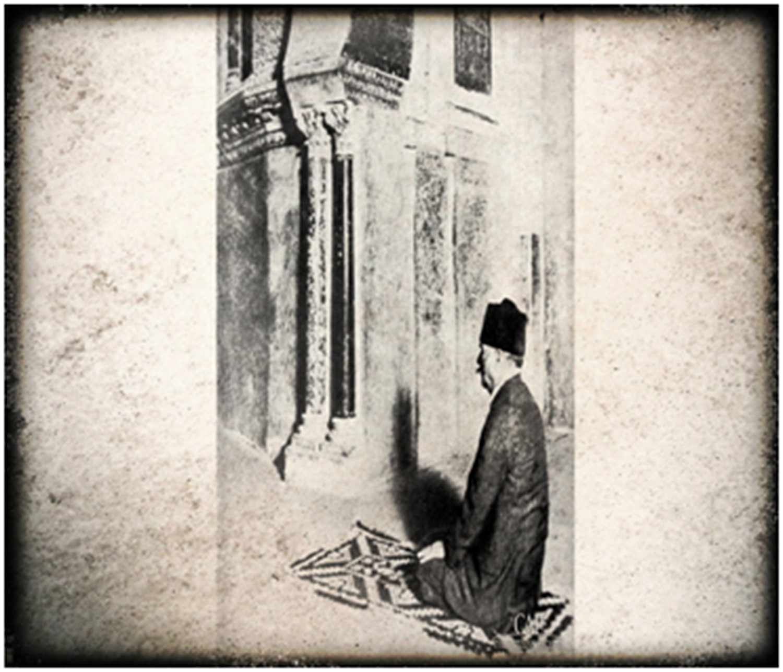 Iqbal praying at the mosque of Cordoba.