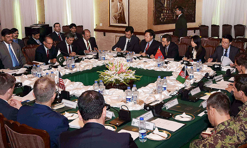 Foreign Secretary Aizaz Ahmad Chaudhry (centre L) chairs the fifth round of four-way peace talks with Afghanistan, US and Chinese delegates at the Foreign Ministry in Islamabad.─APP