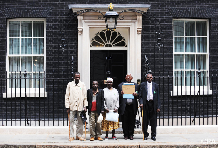 Members of Kenya's Mau Mau resistance movement at Downing Street. ─ Stefan Rousseau/PA Archive/Press Association Images