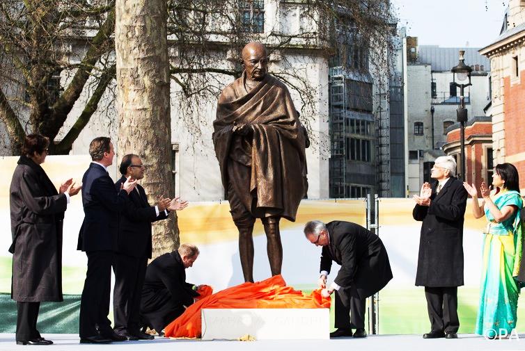 Revered now. Imprisoned then: Mahatma Gandhi. ─ Daniel Leal-Olivas/PA Archive/Press Association Images