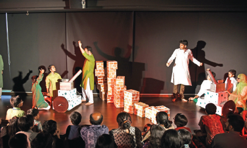 A scene from the play Deewar Keh Uss Paar staged in Islamabad. — Photo by Khurram Amin