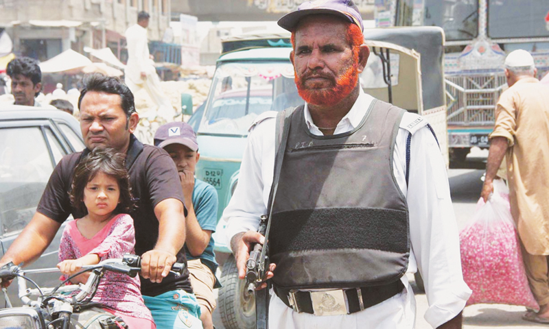 A traffic policeman is wearing a bulletproof vest and carries a gun for his safety while on duty on Sunday.—Online