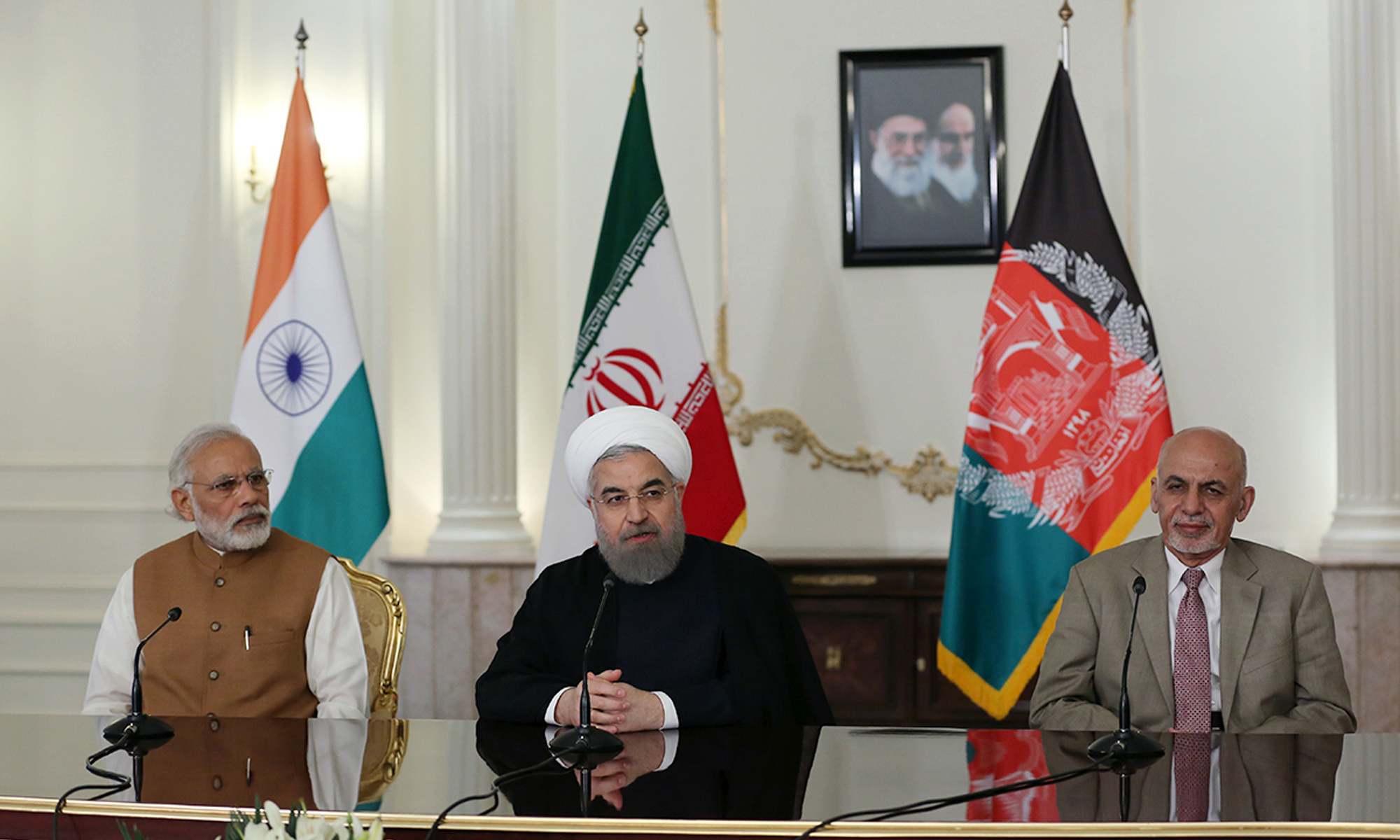 Iranian President Hassan Rouhani, speaks in a joint press briefing with Indian Prime Minister Narendra Modi and Afghanistan President Ashraf Ghani. AP