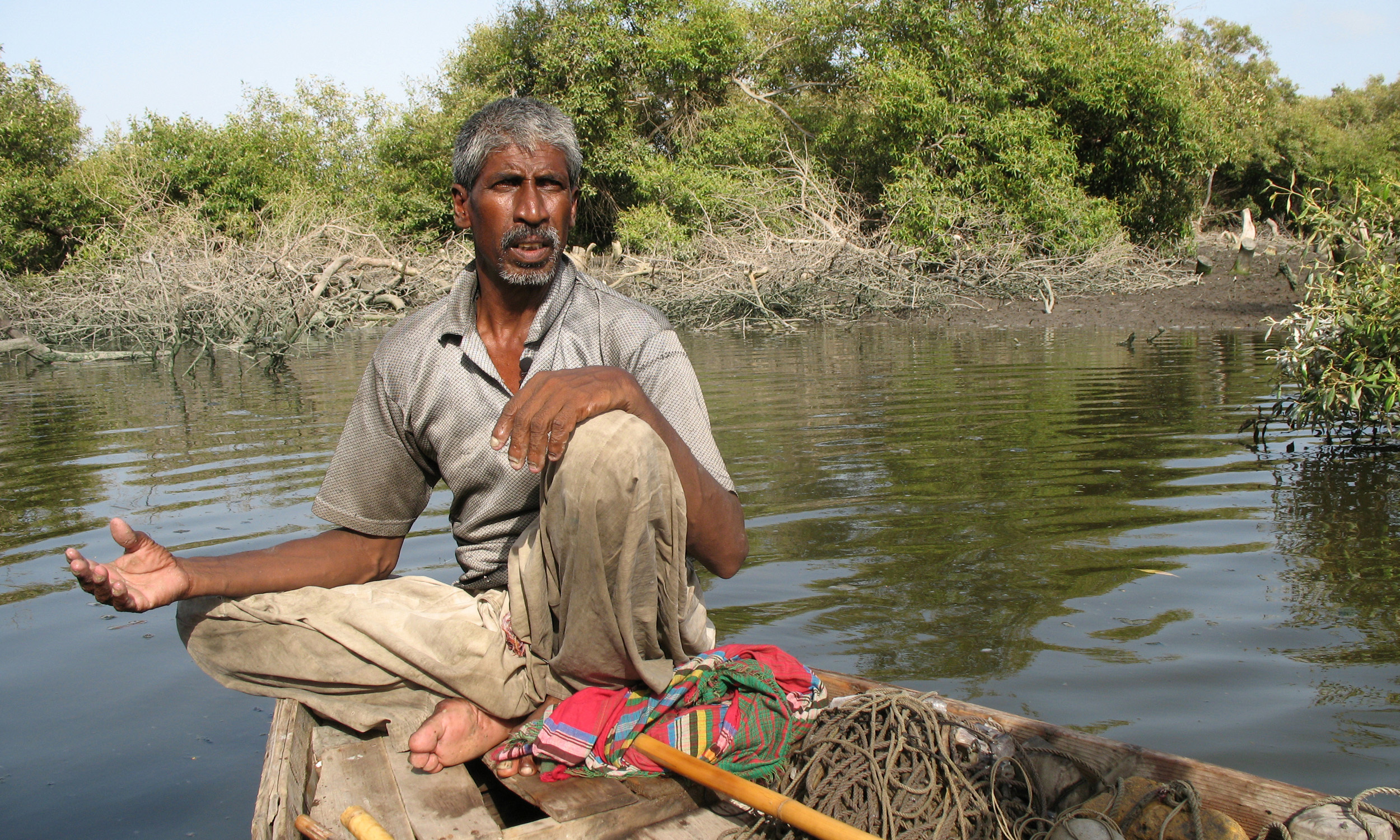 A fisherman in the backwaters of Sandspit Beach in Karachi