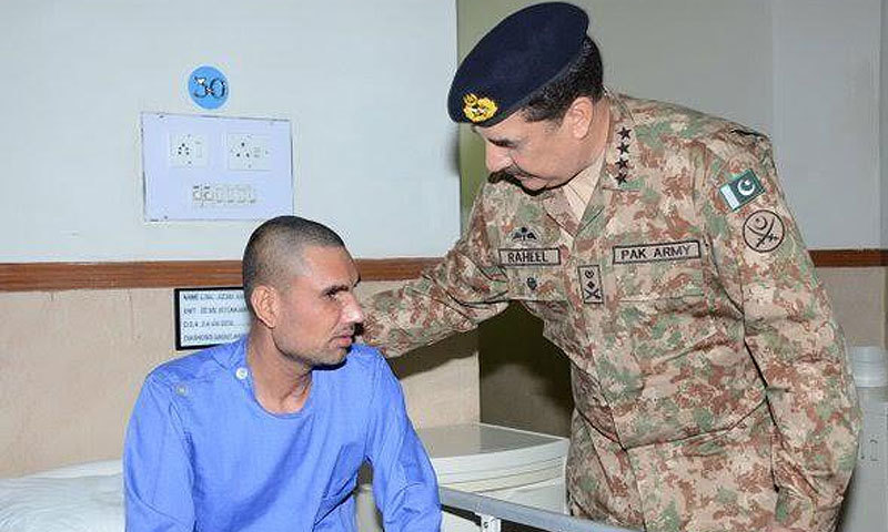 Gen Raheel inquires about health of a visually impaired soldier. ─ISPR