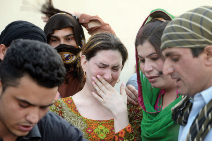 A transgender mourns the death of Alisha in Peshawar on Wednesday. — Photo by Shahbaz Butt