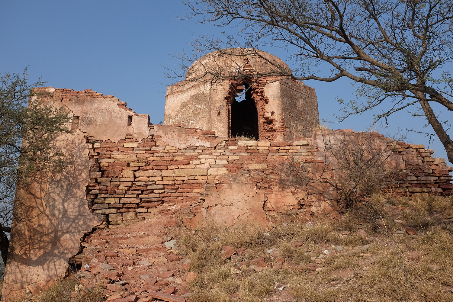 The temple at the top is the only building which has survived inside Kusak fort.