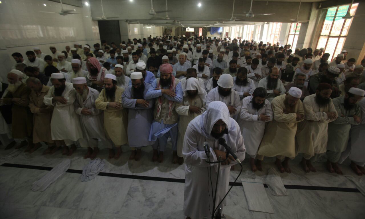 Funeral prayers in absentia were offered at Jamia Masjid Khyber Markaz and attended by hundreds of JuD activists. —DawnNews photo