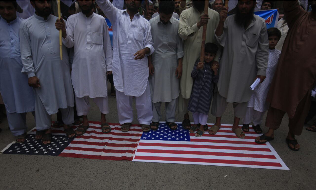 Attendees of the rally chanted slogans against US government and later desecrated the American flag. —DawnNews photo