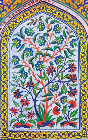 Floral pattern cut tile mosaic within an arch