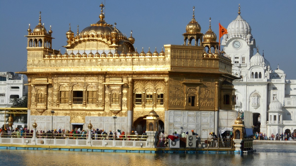 A lovely view of the Golden Temple, on the left is the  causeway to the holy site