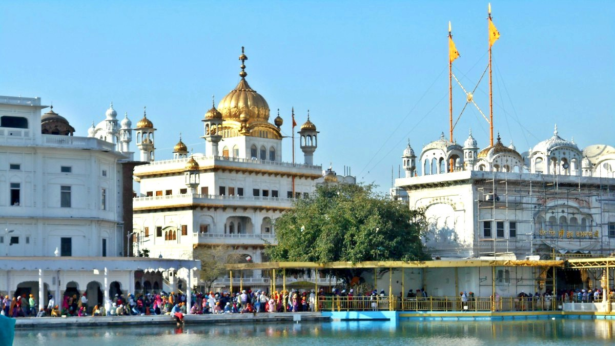 The building with the golden dome is Akali Takht, the  temporal site of the Golden Temple premises